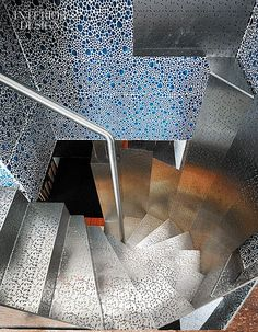 Pattern Language: Xpiral Designs An 'Inverted Penthouse' In Spain | Structurally, the stainless-steel staircase is suspended from the concrete slab above. #design #interiordesign #interiordesignmagazine #architecture #staircase #steel
