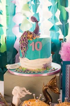 The fondant mermaid topping this birthday cake is gorgeous!! See more party ideas and share yours at CatchMyParty.com #mermaid #birthdaycake