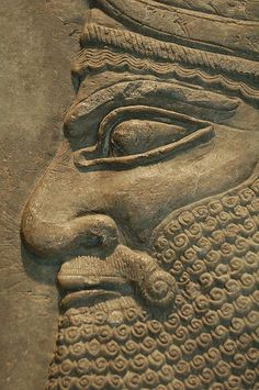 Nimrud (Kalhu): Detail of a relief showing the head of a 'winged genius'. King Ashurnasirpal II (883-859 BC) The carving once decor-ated a reception room in the Royal Palace built by the king in his new capital city on the banks of the Tigris river.