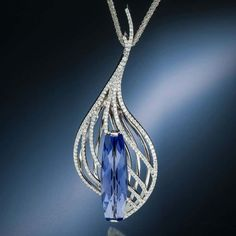 Scintilla tanzanite pendant features a dazzling tanzanite with Stephen Avery�s signature diamond-back cut accented by diamonds set in white gold.