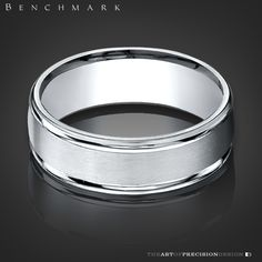 This popular Benchmark 6mm comfort-fit carved design band features a satin-finished surface with a high polished round edge for noticeable style.