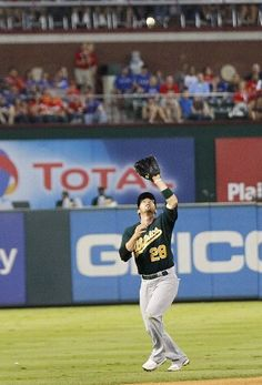 ARLINGTON, TX - MAY 16: Eric Sogard #28 of the Oakland Athletics makes the catch on a pop fly hit by Alberto Gonzalez #14 of the Texas Rangers at Rangers Ballpark in Arlington on May 16, 2012 in Arlington, Texas. (Photo by Rick Yeatts/Getty Images)