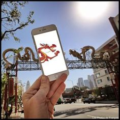 Mushu visits L.A.'s Chinatown. | This Guy Uses His iPhone To Insert Pop Culture Characters Into Real Life