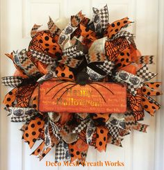 Dress up your front door with this beautiful Halloween wreath. Made on a black work wreath frame with black, orange and cream paper mesh ruffles, spider web ribbon, antique black harlequin ribbon, skull ribbon, orange and black polka dot ribbon and Halloween chevron ribbon. To finish off the look a light up Happy Halloween sign. (2 AA batteries not included.) All of my wreaths are made out of paper mesh. They can be used on a front door. During inclement weather, I would recommend bringing…