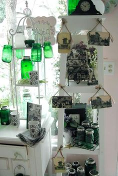 Vintage Paris postcards and green glass merchandising display.  www.violetcottage.com