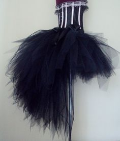 Black Tutu Skirt stunning skirt with yards of tulle 12 / 14ins at the front with a long bustle at the back .
