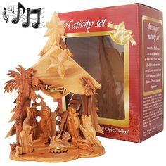 Hand made by a Christian family in the town of Jesus birth, Bethlehem. This authentic all Olive Wood Nativity features soil and added music box that plays 'Silent Night' when you turn the Star of Bethlehem on the Nativity rooftop. Size: 8 x 6 inches.
