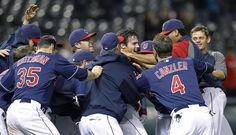 Cleveland Indians' Jason Donald is mobbed by teammates after hitting the game-winning single off Chicago White Sox pitcher Nate Jones in the 12th inning of a baseball game, Tuesday, Oct. 2, 2012, in Cleveland. Lonnie Chisenhall scored. The Indians won 4-3.