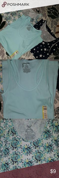 Lot of 3 Tank Tops Lot of 3 Tank tops, all size large in shades of blue. 2 nwot, 1 nwt(stickers.) Great for layering of by themselves, all have a little bit of stretch to them. 1 pale blue racerback, the other 2 are more of a muscle tank style, navy blue w/ white stars and white w/ blue mandala/dream catcher kind of print. Bundle to save even more $! No Boundaries Tops Tank Tops
