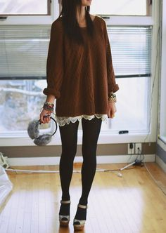 So cute and cozy! Brown sweater and ear muffs