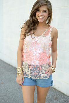 """We are loving this floral-in-coral top so much we can hardly stand it! The hint of glitter from the sparkly-gold embroidery makes this top shine! This sheer tank is almost completely see through and you'll have so much fun pairing it with different colored camies or bandeaus! :) Fits true to size. Miranda is wearing the Small/Medium.  All sizes: Shoulder to hem - 26"""""""