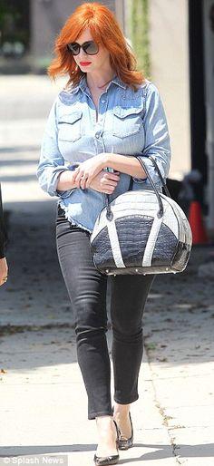 #ChristinaHendricks #fashion #Madmen and #FarbodBarsum  What, this old thing? Christina Hendricks accessorises tattered denim shirt with £15,000 handbag