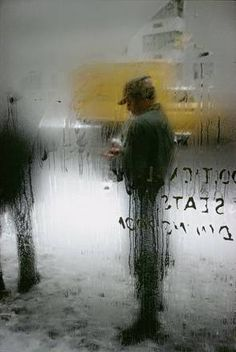 Saul Leiter - love the idea of shooting through wet glass...possibly portraits