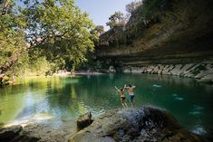 Couple jumping into hamilton pool in dripping springs near austin texas Hamilton Pool Preserve, Texas Swimming Holes, Visit Austin, Best Swimming, Dripping Springs, Texas Hill Country, Summer Bucket Lists, Day Trips, Places To Visit