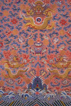 Zoom in of the center dragon on the Woman's Semi-formal Nine Dragon Robe, front side, unknown artist, Qing dynasty (1644-1912), 1874-1908.  Orange-pink silk embroidered with gold-wrapped thread and multicolored silk floss.  Gift of Mason DeNeffe.