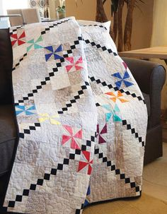 Bright pinwheels abound in this simple scrap quilt.