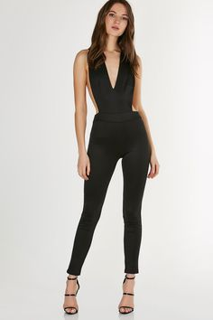 64b80289a97b2 Simple sleeveless jumpsuit with stretchy fit. Plunging V-neckline and sexy  open back with