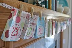 what a cute idea for an advent calendar, plus it looks great hanging on the mantle.