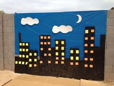"""Super Hero back drop. Blue tarp in background, boxes spray painted black and post it notes for the """"windows""""? Avengers Birthday, Batman Birthday, Batman Party, Superhero Birthday Party, 4th Birthday Parties, Lego Batman, 3rd Birthday, Spider Man Party, Avenger Party"""