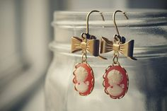 cameo earings with gold bows