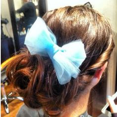 Cute updo with bow.