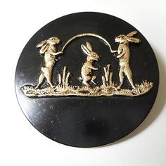 Large-Brass-Rabbits-Playing-Jump-Rope-Button-2-Painted