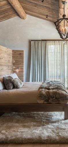Modern Rustic Bedroom Designed by Pearson Design Group #logcabins #rustichomes #ranchhomes #rusticbedroom #rusticbedroomideas #loghomelivingrooms #greatrooms #rusticgreatrooms #loghomegreatrooms Modern Rustic Bedrooms, Rustic Bedroom Design, Modern Rustic Decor, Rustic Bathrooms, Rustic Design, Timber Homes, Log Homes, Log Home Kitchens, Log Home Living