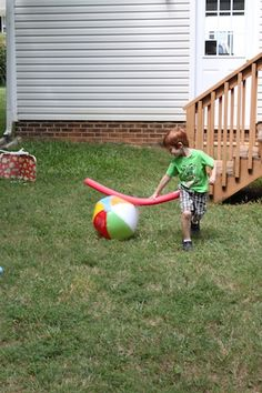 A pool noodle and beach ball, lots of safe outdoor toddler fun.