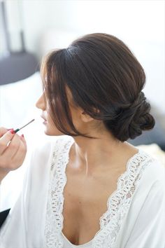 wedding hairstyle pulled back in bun with side swept bangs