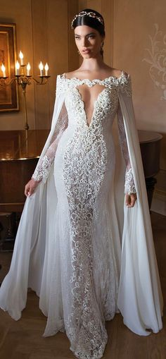 Stunning wedding dress with lace and a cape. Lil bit more closed in at the top and it would be perfect