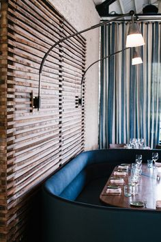 The Optimist | Smith Hanes. restaurant booth seating and lighting
