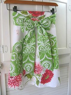 Vintage tablecloth into skirt or apron with bow