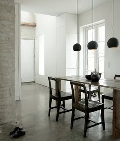 Utilitarian scheme dining room with polished concrete floor