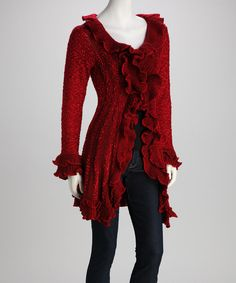 Cover up with this cozy knit jacket that makes a stylish statement all on its own. Varied textures and ruffle-embellished hems contribute to its alluring design.Measurements (size S): 36'' long from high point of shoulder to hem50% acrylic / 50% polyesterHand wash; dry flatImported