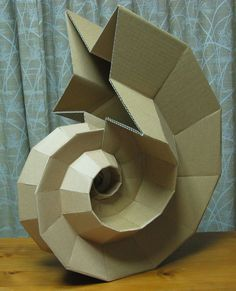 This post lists 30 stunning paper art examples that you can use to inspire and enlighten you on the many objects that can be made from an ordinary paper Cardboard Sculpture, Cardboard Paper, Cardboard Crafts, 3d Paper, Sculpture Art, Origami 3d, Paper Crafts Origami, Paper Structure, Paper Engineering