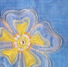 Machine embroidered sun flower by Joy Clucas http://www.embroiderersguild.com/