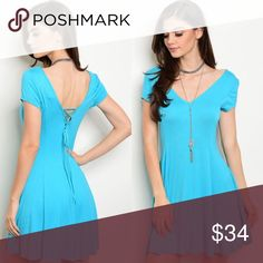 Turquoise Short Sleeve V-Neck Lace-Up Back Dress New with tags. Lace-up back shirt dress.                                                   🌸96% rayon, 4% spandex.                                                              🌸Made in USA.                                                                         ❌SORRY, NO TRADES. Boutique Dresses Mini