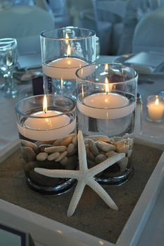 Candles at a beach wedding beach centerpieces, nautical wedding centerpieces, beach theme decorations, Beach Wedding Centerpieces, Diy Centerpieces, Wedding Decorations, Beach Decorations, Nautical Centerpiece, Centerpiece Flowers, Quinceanera Centerpieces, Decor Wedding, Hurricane Centerpiece