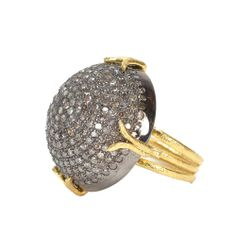 Io Ring A dome of rhodium plated sterling silver set with pavé diamonds is held by 22K gold triple band.