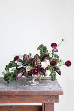 A Recipe In Bloom: Maria Maxit in Houston uses greens and splashes of burgundy to design an aromatic arrangement that smells, if not tastes, as good as it looks. – @flowermag