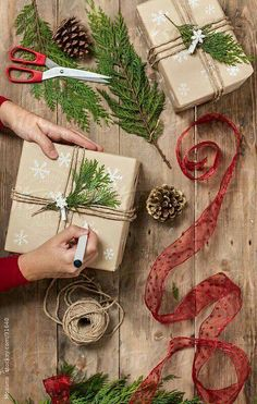 Love this idea for simple, yet beautiful wrapping paper. Hand-drawn snowflakes, Kraft Brown paper, triple-wrapped twine and an evergreen sprig. Try some personalized Avery Labels or Printable Tag to dress up your Christmas gifts. Christmas Crafts For Gifts, Christmas Gift Wrapping, Xmas Gifts, Christmas Time, Christmas Cards, Christmas Decorations, Christmas Packages, Gift Crafts, Womens Christmas Gifts