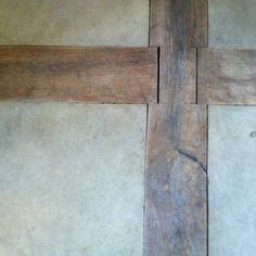 Cement or stone inlaid into wood beams on the floor in Bunny William's Connecticut guest-barn. I like how rustic they are and would love to do something similar in our barn to house renovation.