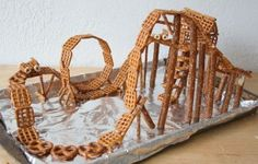 Genius pretzel roller coaster for at least an hour (or more!) of fun. Use all kinds of crunchy snacks. Edible Crafts, Vbs Crafts, Food Crafts, Edible Art, Crafts To Make, Crafts For Kids, Build A Better World, Bible School Crafts, Worlds Of Fun