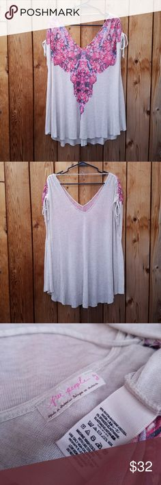 Free People Cream & Pink Oversized Top Adorable! Sleeves have an adjustable drawstring along the top Excellent condition  Feel free to ask me any additional questions! Bundles 3+ are 15% off. No trades, or modeling. Happy Poshing! Free People Tops