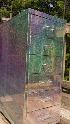 Old file cabinet redone with holographic covering!