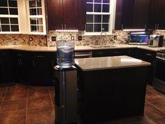 Kitchen Remodel by M.A.K. Construction Services- Craftsman Java Maple Wood Cabinets, Backsplash- Glass Subway Tile, Center Island, Silestone Countertops, Ceramic Floor Tile, Undercabinet LED Lighting