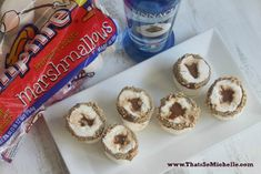 S'mores Jello Shots in Real Marshmallows ; this is a little elaborate but a definite may