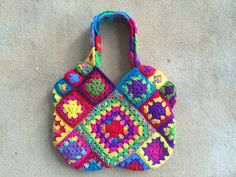 This weekend I was bound and determined to finish the third in what has become a series of bags. The first order of business was to complete the two-round granny squares I would need for the strap/...