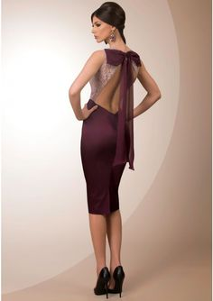 Lace and satin cocktail gown Open back style with bow detail Back closes with zipper