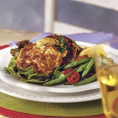 Just before serving, toss mixed baby greens with olive oil, salt, and pepper to taste, as many restaurants do. Place crab cakes on top....